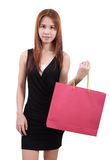 Woman in shopping. Young asian woman with red shopping bag on white background Stock Image