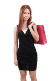 Woman in shopping. Young asian woman with red shopping bag on white background Royalty Free Stock Image
