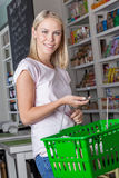 Woman shopping. Young woman shopping in the market Royalty Free Stock Photography