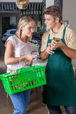 Woman shopping. Young women shopping food and ask to seller Royalty Free Stock Photography