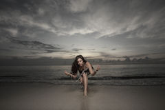 Woman by the shore Stock Images