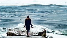 A woman on the shore of a frozen sea. Sea ice. A woman on the shore of a frozen sea. Sea ice Royalty Free Stock Photography