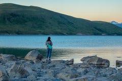 Woman on Shore of Lake Tekapo royalty free stock photos