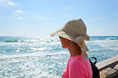 Woman on a shore of Mediterranean sea Royalty Free Stock Image