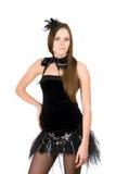 Woman in a short black dress. Portrait of pretty young woman in a short black dress Stock Photo