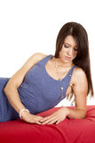 Woman short blue dress lay on red sheet look down Stock Images