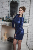 Woman  in short blue dress near commode Royalty Free Stock Photo