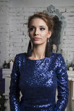 Woman  in short blue dress near decorated commode Royalty Free Stock Photos