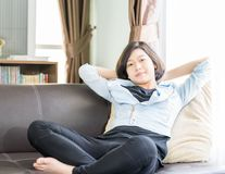 Woman short hair relaxation in living room Royalty Free Stock Images