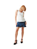 Woman in short skirt. A young woman in short skirt and high heels over white background Stock Images