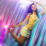 Woman in short skirt at the night club Stock Photo