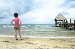 Woman in shorts at the beach Stock Image