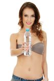 Woman in shorts and bra with water. Stock Photos