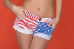 Woman in shorts colors of USA flag Royalty Free Stock Image
