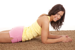 Woman in shorts laying on carpet Royalty Free Stock Image