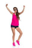 Woman In Shorts And Pink Shirt Cheering Royalty Free Stock Photos