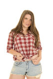 Woman shorts red plaid shirt tie knot Royalty Free Stock Photography