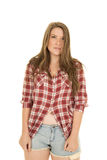 Woman shorts red plaid shirt unbutton serious Royalty Free Stock Photo