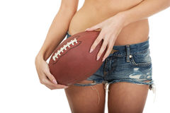 Woman in shorts with rugby ball. Royalty Free Stock Image