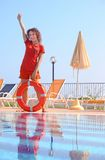 woman in shorts and T-shirt keeps red life buoy Stock Photo
