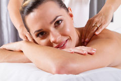 Woman shoulder massage Royalty Free Stock Images