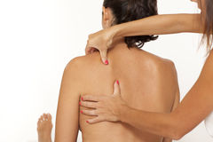 Woman shoulder massage. Massage of shoulder on white background royalty free stock photography