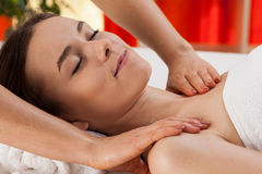 Woman during shoulder massage Stock Photography