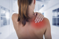 Woman with shoulder pain back, hospital background. Woman with shoulder pain back royalty free stock photography