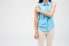Woman with shoulder pain or stiffness. A woman with shoulder pain or stiffness Stock Photo