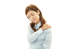 Woman with shoulder pain. Stock Images