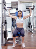 Woman at shoulder press Royalty Free Stock Photography