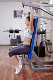 Woman at shoulder press Stock Images