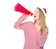 Woman shout with megaphone. Isolated over white background Royalty Free Stock Images
