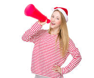 Woman shout with megaphone. Isolated over white background Stock Photos
