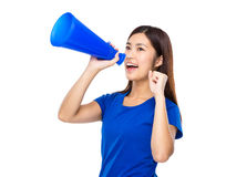 Woman shout with megaphone. Isolated on white background Royalty Free Stock Images