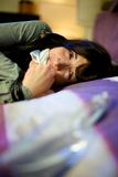 Woman shouting and crying in bed kidnapped Stock Image