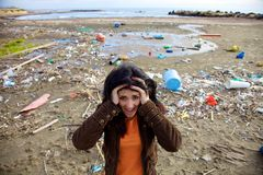 Woman shouting in front of ecologic disaster dirty beach Stock Photo