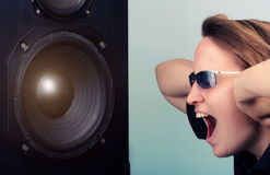 Woman shouting in front of speaker box Stock Image