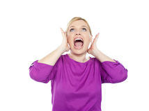 Woman shouting with hands on ears. And looking upwards Stock Photo