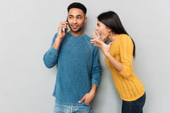 Woman shouting at her husband about phone Stock Photo