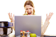 Woman shouting at her laptop Stock Photos