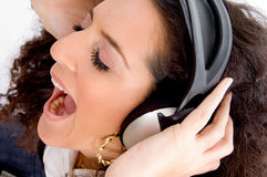 Woman shouting while listening music Royalty Free Stock Photo