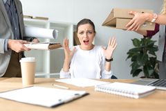 Woman shouting because of lot of work Stock Images
