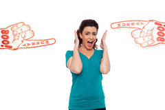 Woman shouting loud, stuck in between. Two large hurray boo foam hands pointing at her royalty free stock images