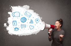 Woman shouting into loudspeaker and modern blue icons and symbol Stock Photos