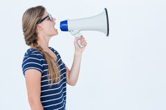 Woman shouting through a loudspeaker Royalty Free Stock Photography