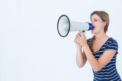 Woman shouting through a loudspeaker Stock Photos