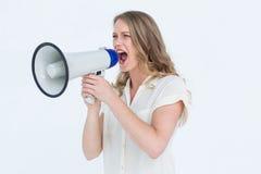 Woman shouting through a loudspeaker Royalty Free Stock Image