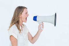 Woman shouting through a loudspeaker Stock Photography
