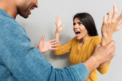 Woman shouting at man Stock Photography